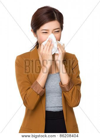 Businesswoman with an allergy sneezing