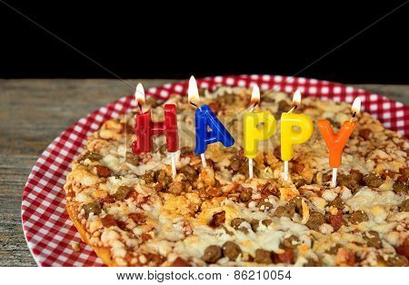 happy birthday candles on pizza