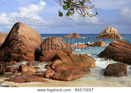 Beautiful large granite boulders on beach of Anse Lazio.