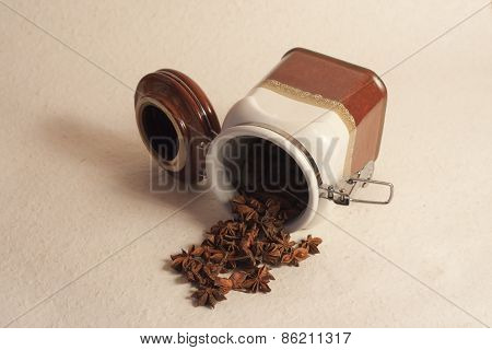 an overturned pot of star anise, indian spices, Indian kitchen