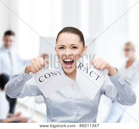 business, documents, people, legal and real estate concept - serious businesswoman tearing contract