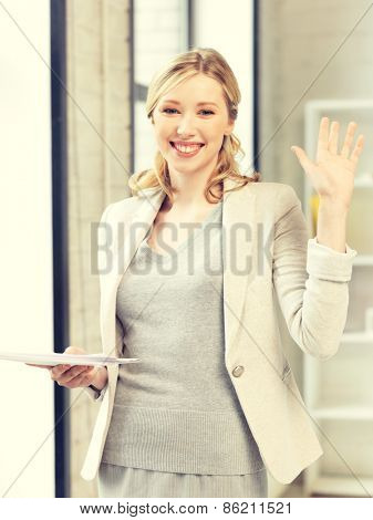 indoor picture of happy woman with documents