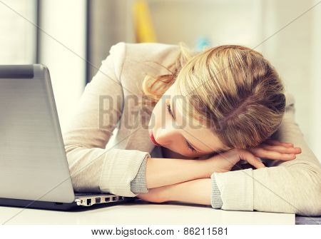 picture of tired woman with laptop computer