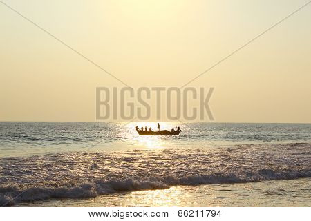 Fishing boat with fishermen floating in the ocean