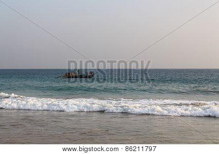 Fishermen in a boat floating in the Indian ocean