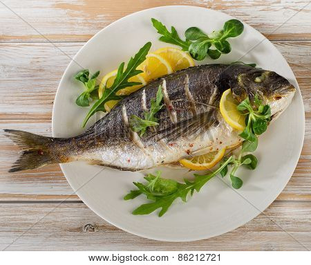 Fried Sea Bream On Plate With Fresh Salad
