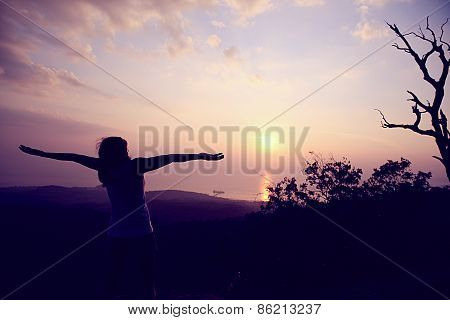 cheering woman open arms