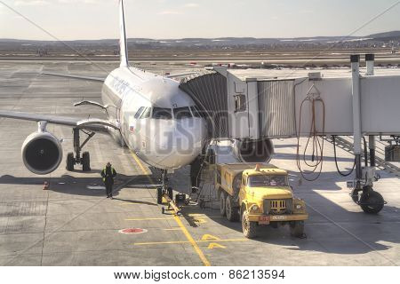 An Airplane Produces Boarding Of Passengers