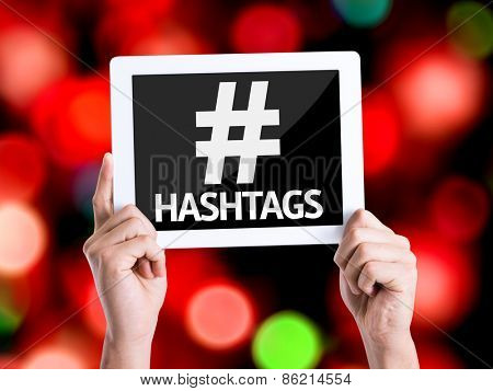 Tablet pc with text Hashtags with bokeh background