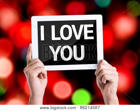 Tablet pc with text I Love You with bokeh background