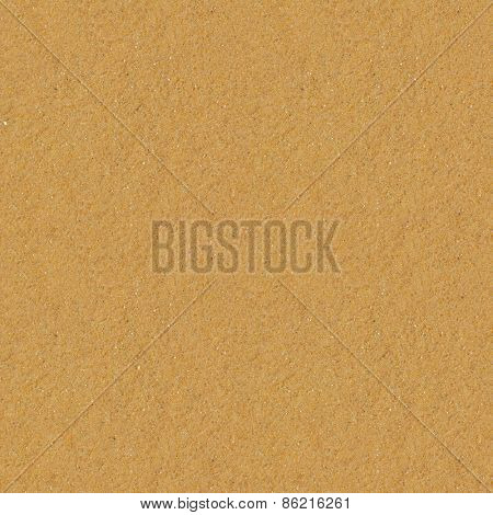 Seamless yellow sand flat surface texture.
