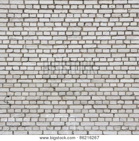 Aged white brick wall seamless texture.