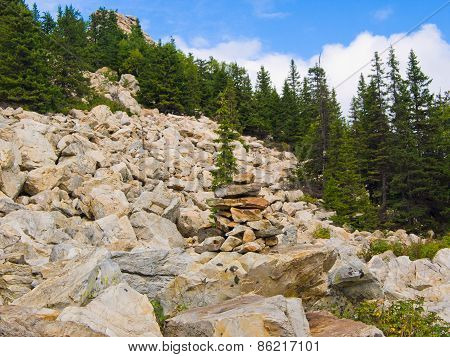 Pyramid of stones on the stone mountainside
