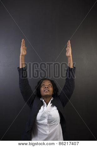 South African Or African American Woman Teacher Or Student Reaching For Sky