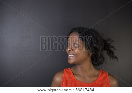 South African Or African American Woman Teacher On Black Background