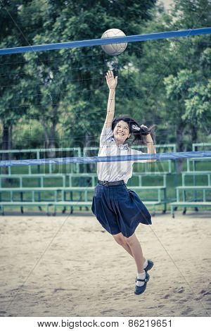 Cute Thai Schoolgirl Is Playing Beach Volleyball In Grunge Style