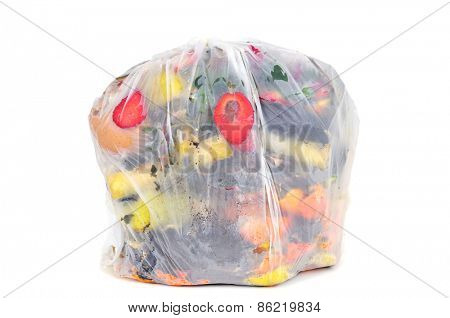 a biodegradable bag full of biodegradable waste on a white background