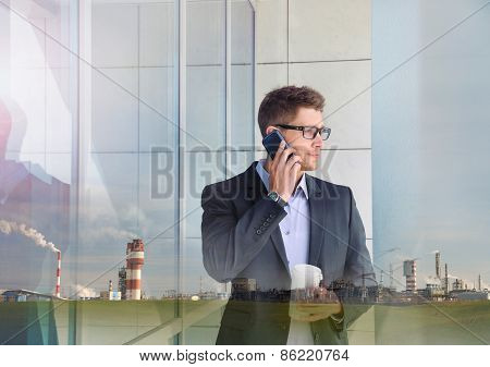 Double Exposure Of Urban Attractive Businessman With Phone Device And Industrial Enterprise