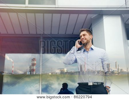 Double Exposure Of Urban Businessman With Phone Device And Industrial Enterprise