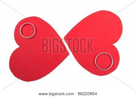 Wedding Rings On Red Hearts Isolated On White