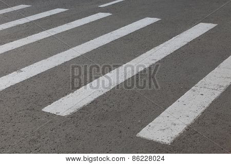 striped marking of the crosswalk on road