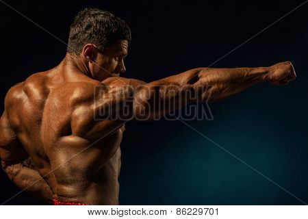 Strong Muscular Man With Outstretched Hand To The Side