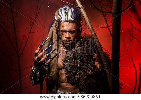 Werewolf With Long Nails And Crooked Teeth Among The Branches Of The Tree.