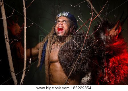 Muscular Werewolf Hair Dreadlocks Among The Branches Of The Tree Screaming