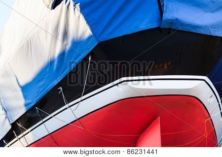 Yacht Stern of Black, White, Blue And Red Colors Close-Up View