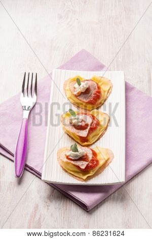 ravioli with ham ricotta and tomato sauce