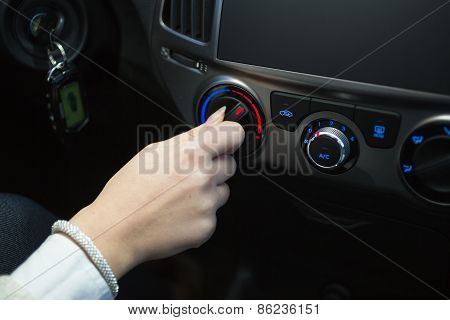 Driver Turning Car Air Conditioner Knob