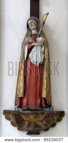 ELLWANGEN, GERMANY - MAY 07: Virgin Mary under the Cross, Basilica of St. Vitus in Ellwangen, Germany on May 07, 2014.