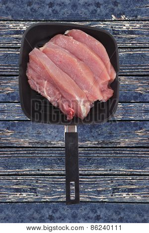 fresh raw turkey meat steak fillet over blue wooden table ready to cooking