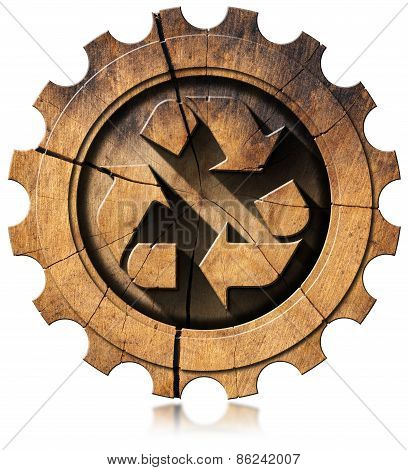 Recycle Symbol On Wooden Gear