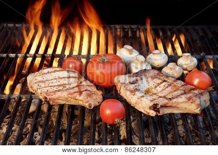 Two Tasty Rib Steaks, Tomato, Mushrooms Cooked Over  Bbq Grill.