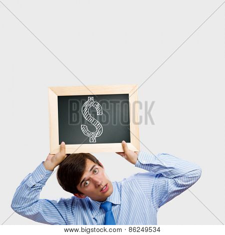 Handsome man holding frame with dollar sign