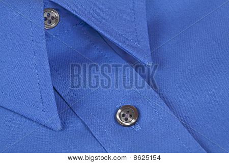 A Blue Shirt With Buttons