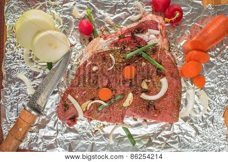 Raw beef meat seasoned and ready to cooked