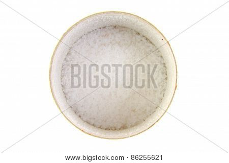Sea salt in a cup on white background