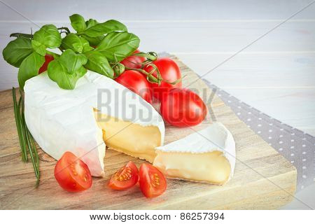 Goat Cheese, Cherry Tomato, And Basil On A Wooden Background