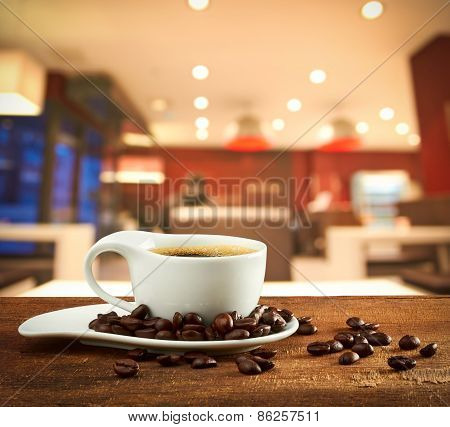 Cup Of Coffee On Blur Cafe Background