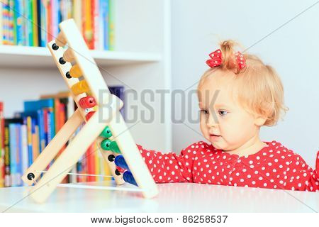 little girl playing with abacus