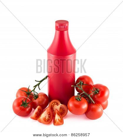 Ketchup copyspace bottle surrounded with tomatoes
