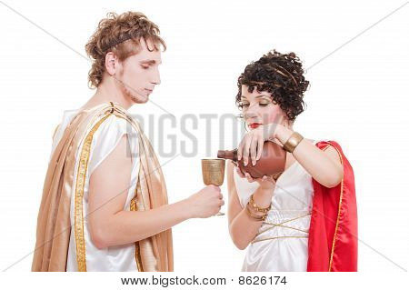 Couple In Greek Style With Wine