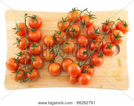 Cherry tomato over cutting board isolated