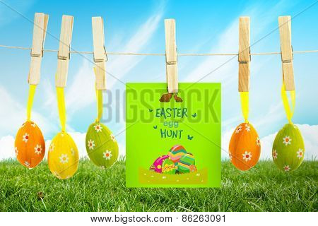 easter egg hunt graphic against field and sky