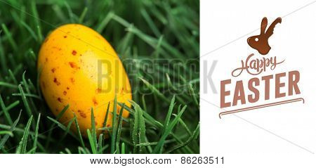happy easter against yellow speckled easter egg