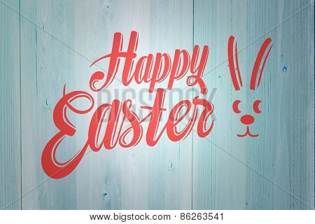Happy easter against faded blue wooden planks
