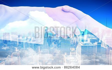 Close up of female and male hand shaking against new york