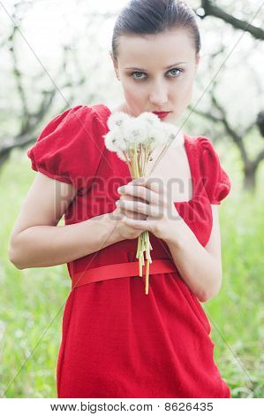 Woman In Red Dress With Posy